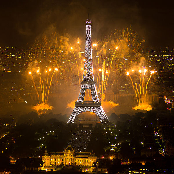 """Fireworks on Eiffel Tower as seen from the Montparnasse Tower, July 14, 2011"" by Yann Caradec from Paris, France [CC BY-SA 2.0 (https://creativecommons.org/licenses/by-sa/2.0/deed.en)], via Wikimedia Commons"